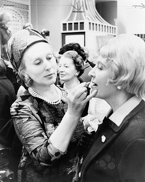 Estée Lauder with a customer.